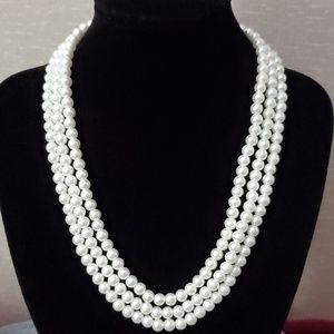 Set of three string pearl necklace and bracelet.
